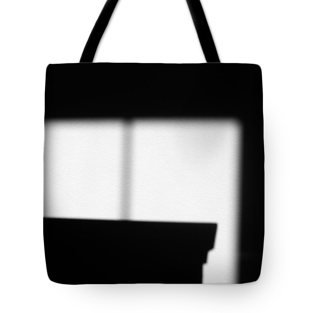 Wall.window Tote Bag featuring the photograph Wall Window Shadow by Catherine Lau