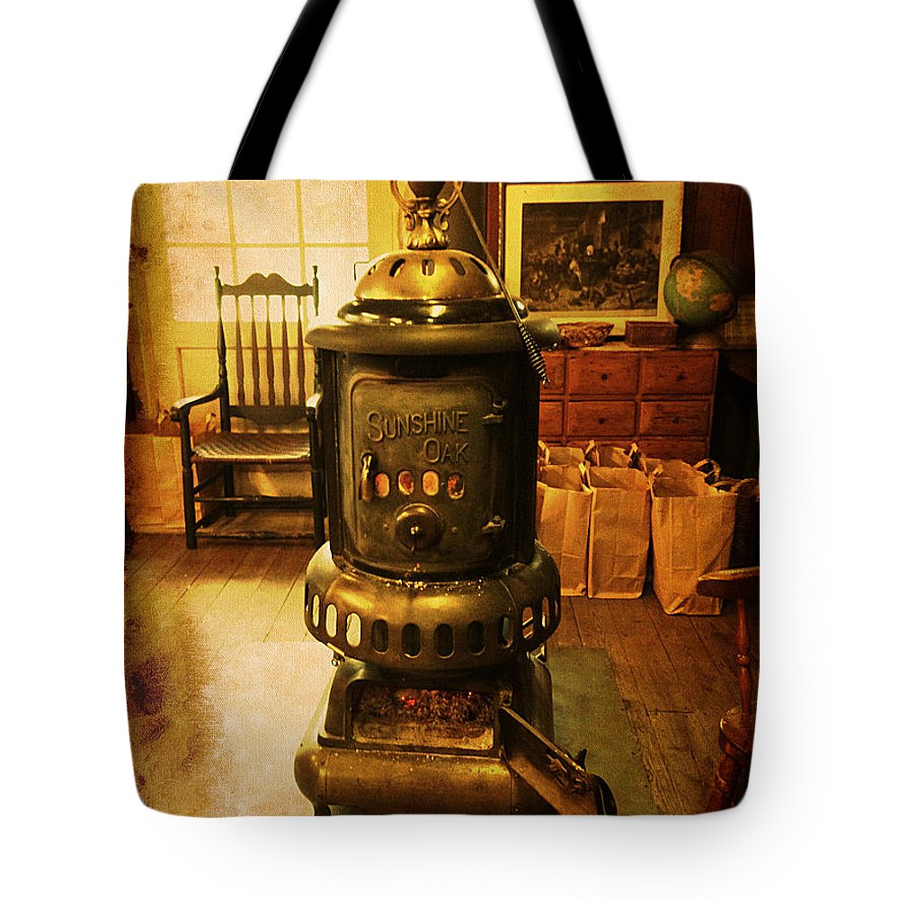 Stove Tote Bag featuring the photograph Warming The Place Up by Richard Reeve