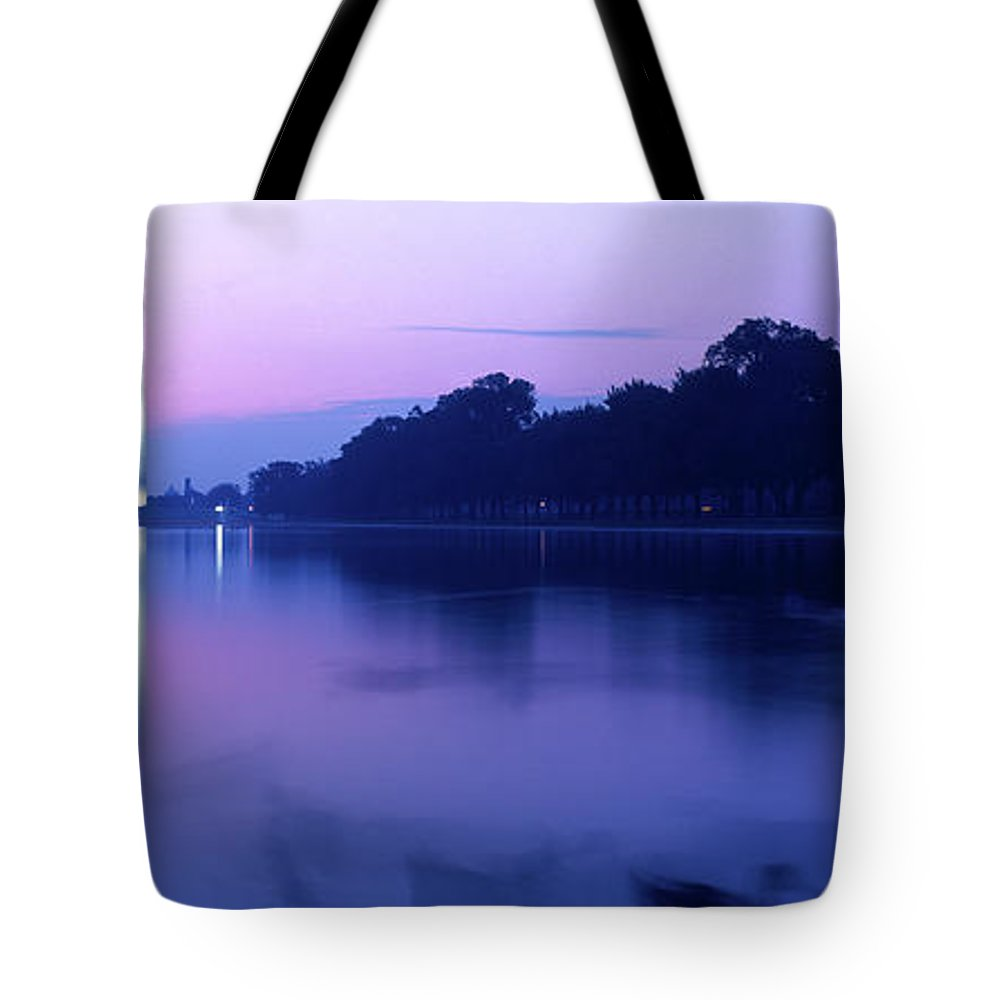 Photography Tote Bag featuring the photograph Washington Monument Reflecting In Pool by Panoramic Images