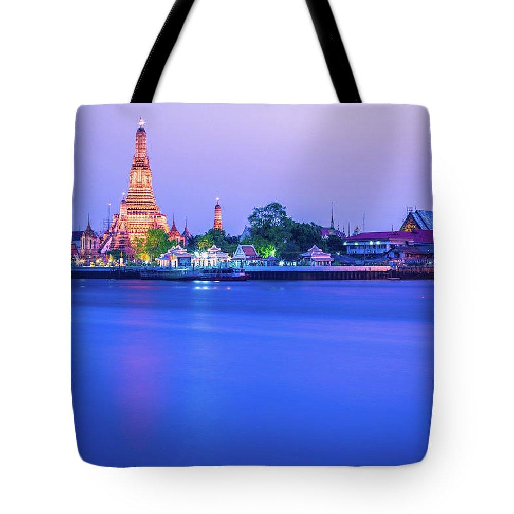 Scenics Tote Bag featuring the photograph Wat Arun Temple Bangkok Thailand by Deimagine