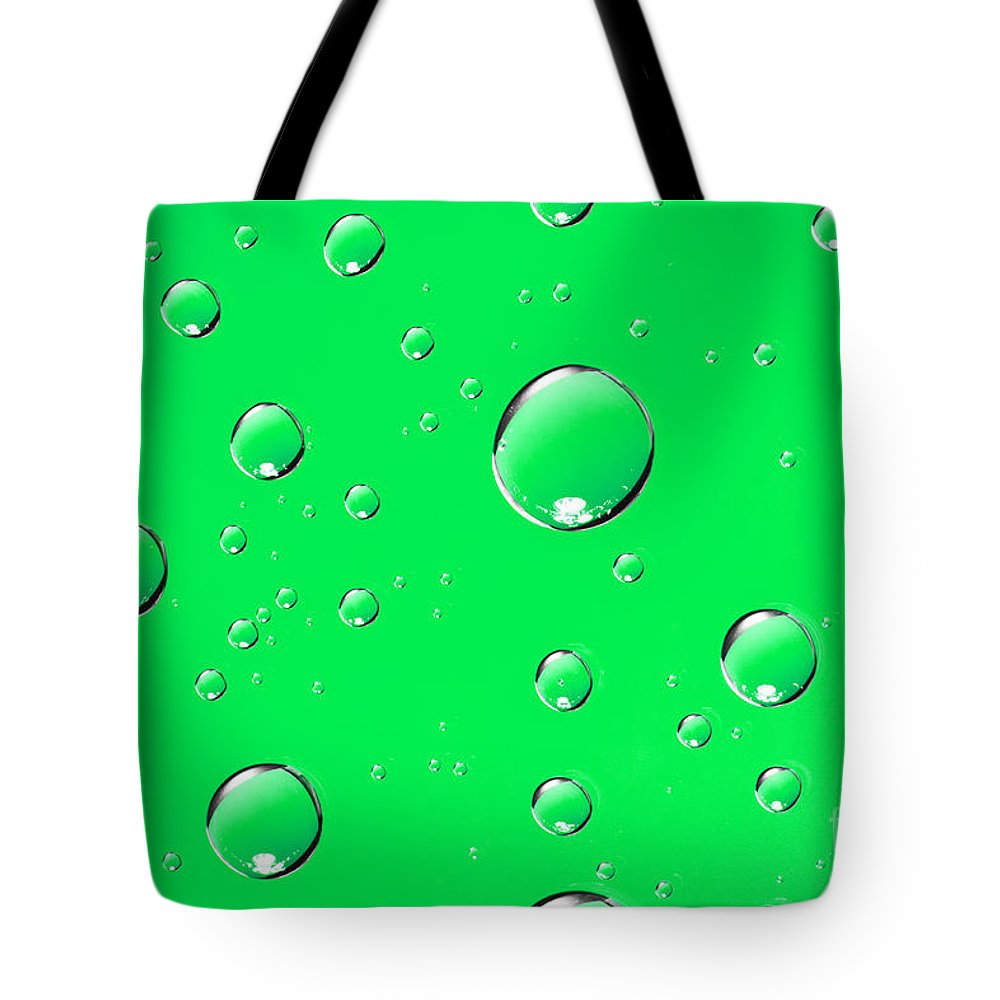 Water Tote Bag featuring the photograph Water Drops On Green by Sharon Dominick