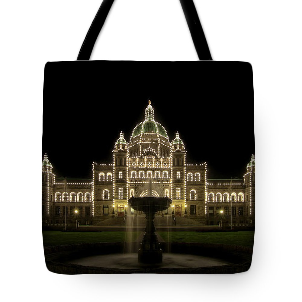 Parliament Tote Bag featuring the photograph Water Fountain By Parliament Buildings In Victoria Bc by Jit Lim