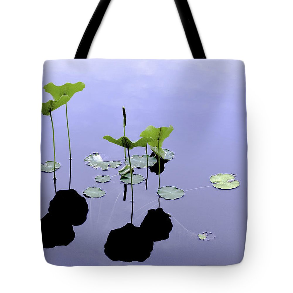 Lilies Tote Bag featuring the photograph Water Lilies by Adam Kilbourne