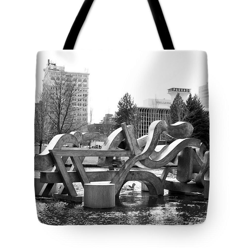 Spokane Tote Bag featuring the photograph Water Sculpture In Spokane by Carol Groenen