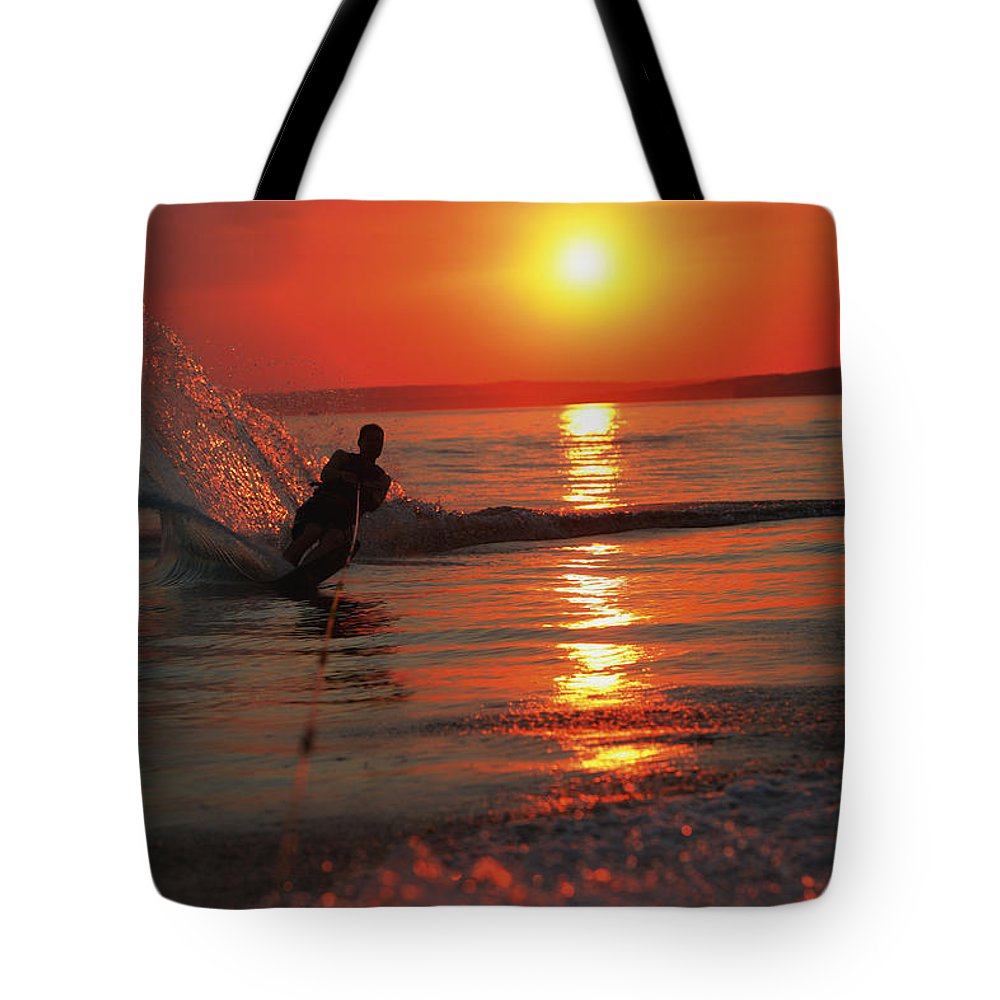 Alberta Tote Bag featuring the photograph Waterskiing At Sunset by Misty Bedwell