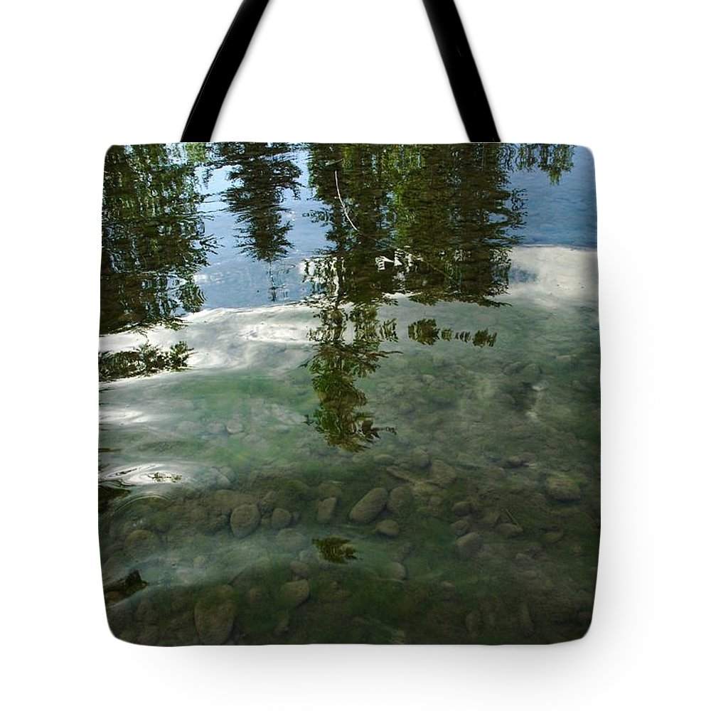 Tote Bag featuring the photograph Wavering Reflections by Jeff Swan
