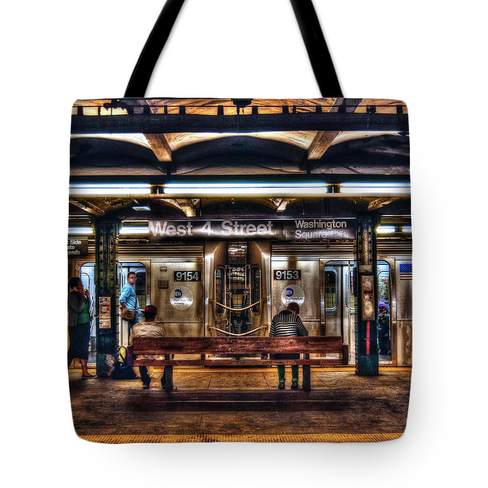Manhattan Tote Bag featuring the photograph West 4th Street Subway by Randy Aveille