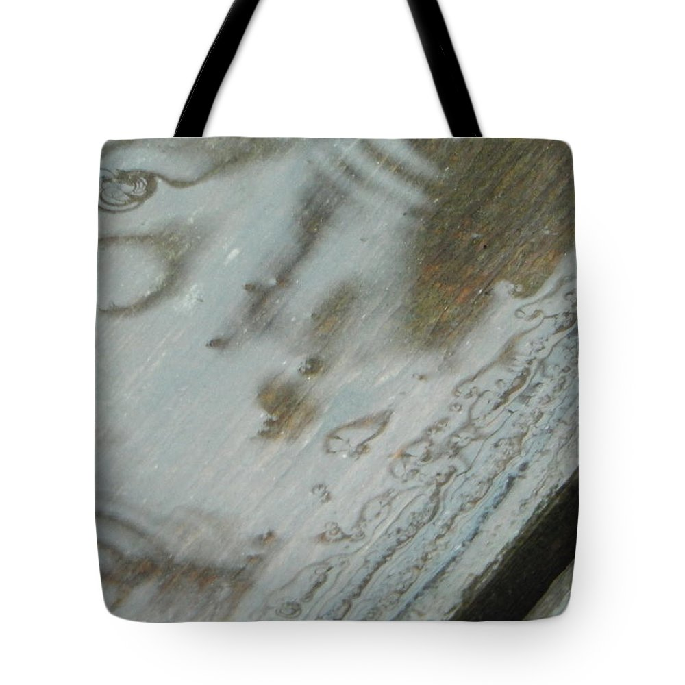 Cedar Boards Tote Bag featuring the photograph Wet Deck by Betty-Anne McDonald