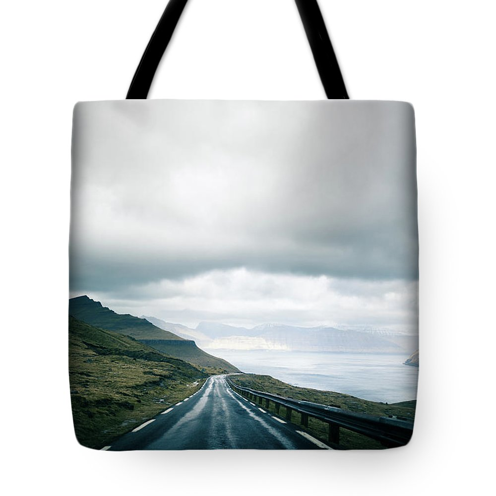 Tranquility Tote Bag featuring the photograph Wet Road by Annelogue Photography