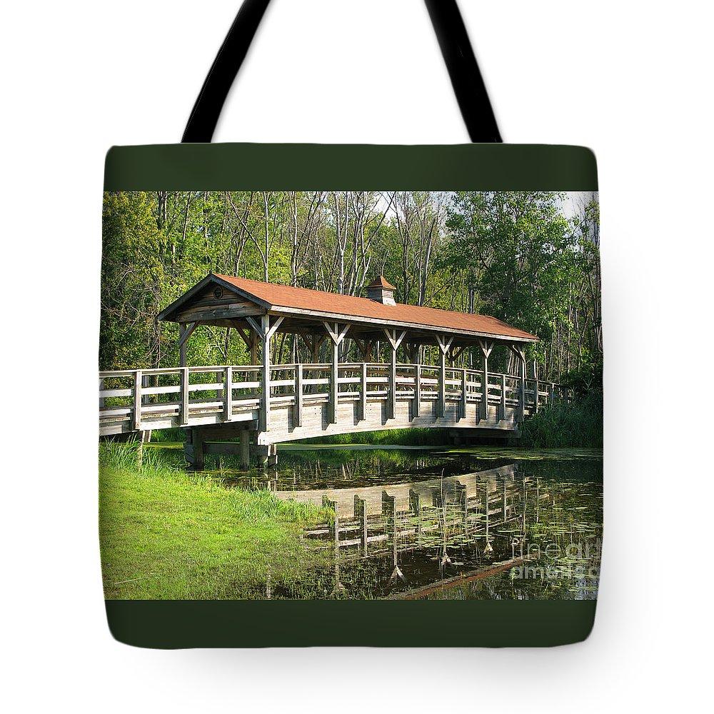 Bridge Tote Bag featuring the photograph Wetland Footbridge by Ann Horn