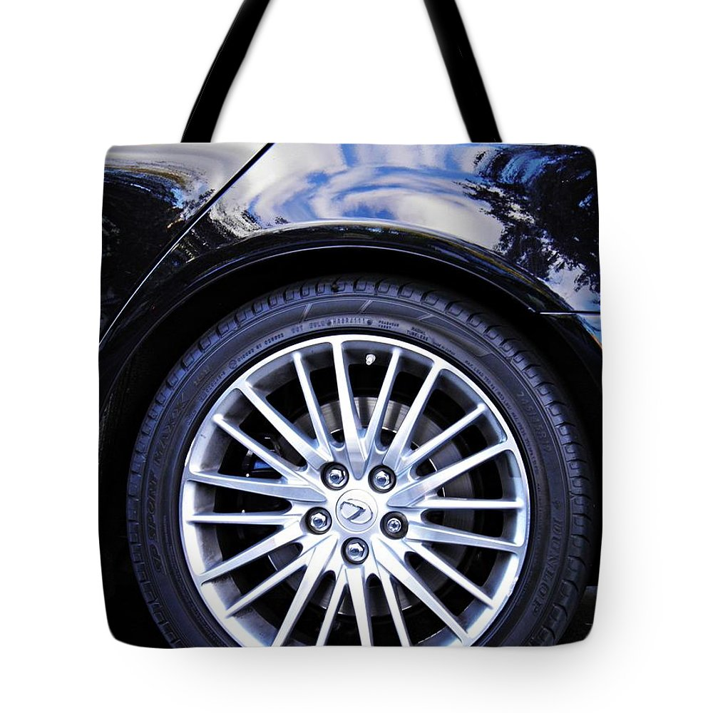 Wheel Tote Bag featuring the photograph Wheel by Sarah Loft
