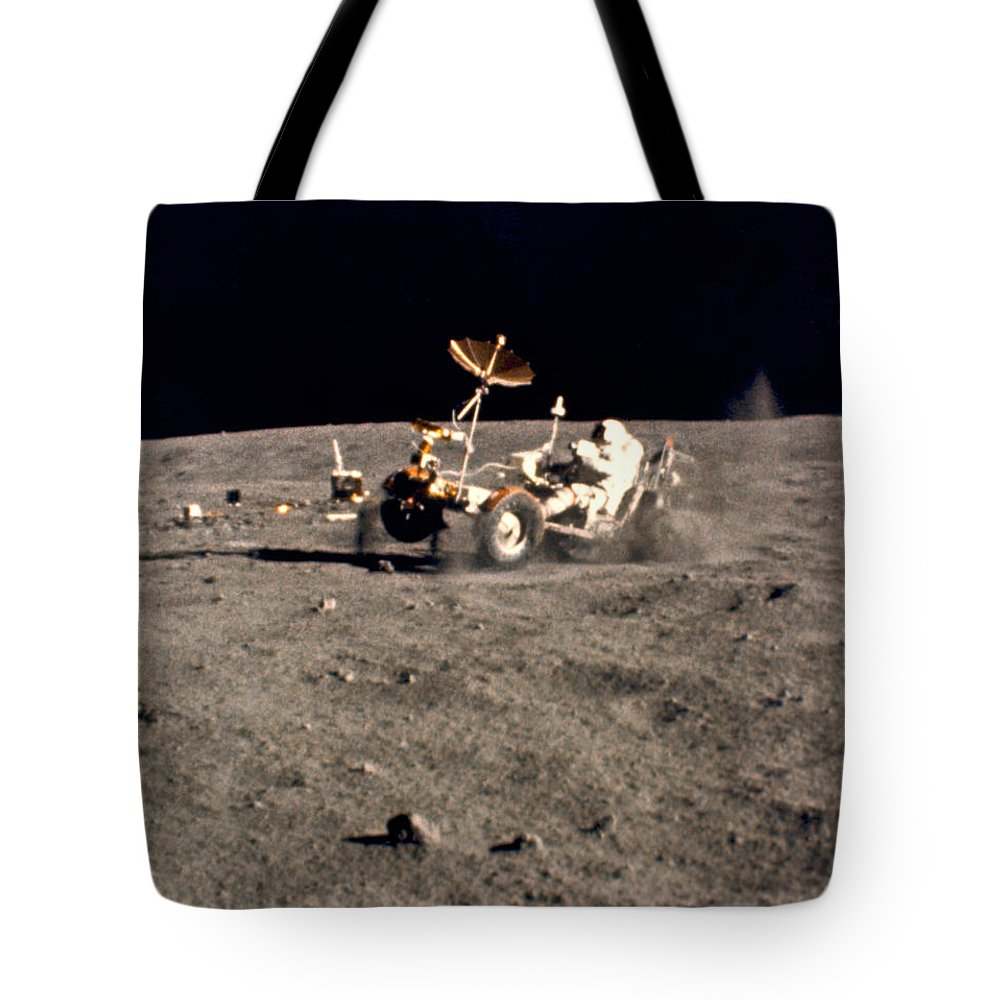 1 Person Tote Bag featuring the photograph Wheelie On The Moon by Underwood Archives