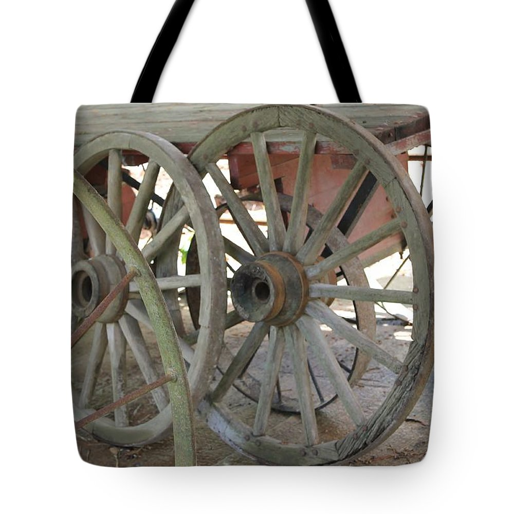 Wheels Tote Bag featuring the photograph Wheels by Mary Koval