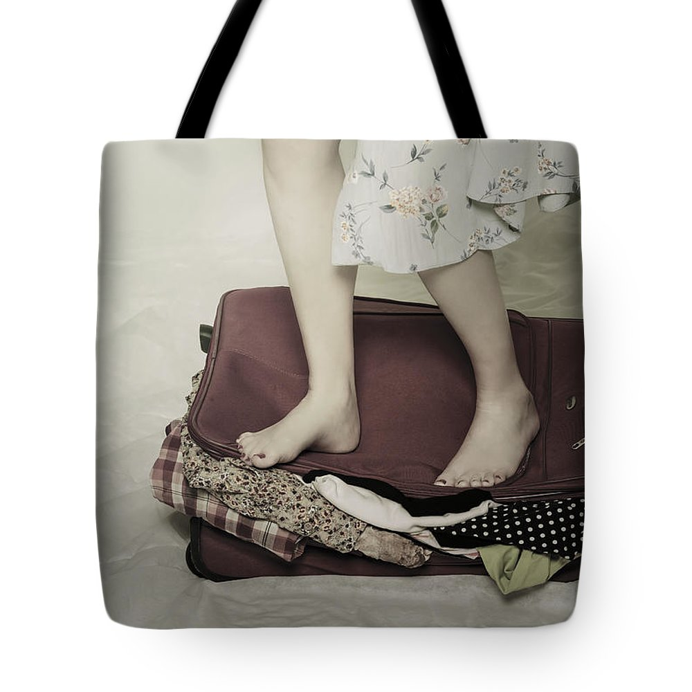 Woman Tote Bag featuring the photograph When A Woman Travels by Joana Kruse