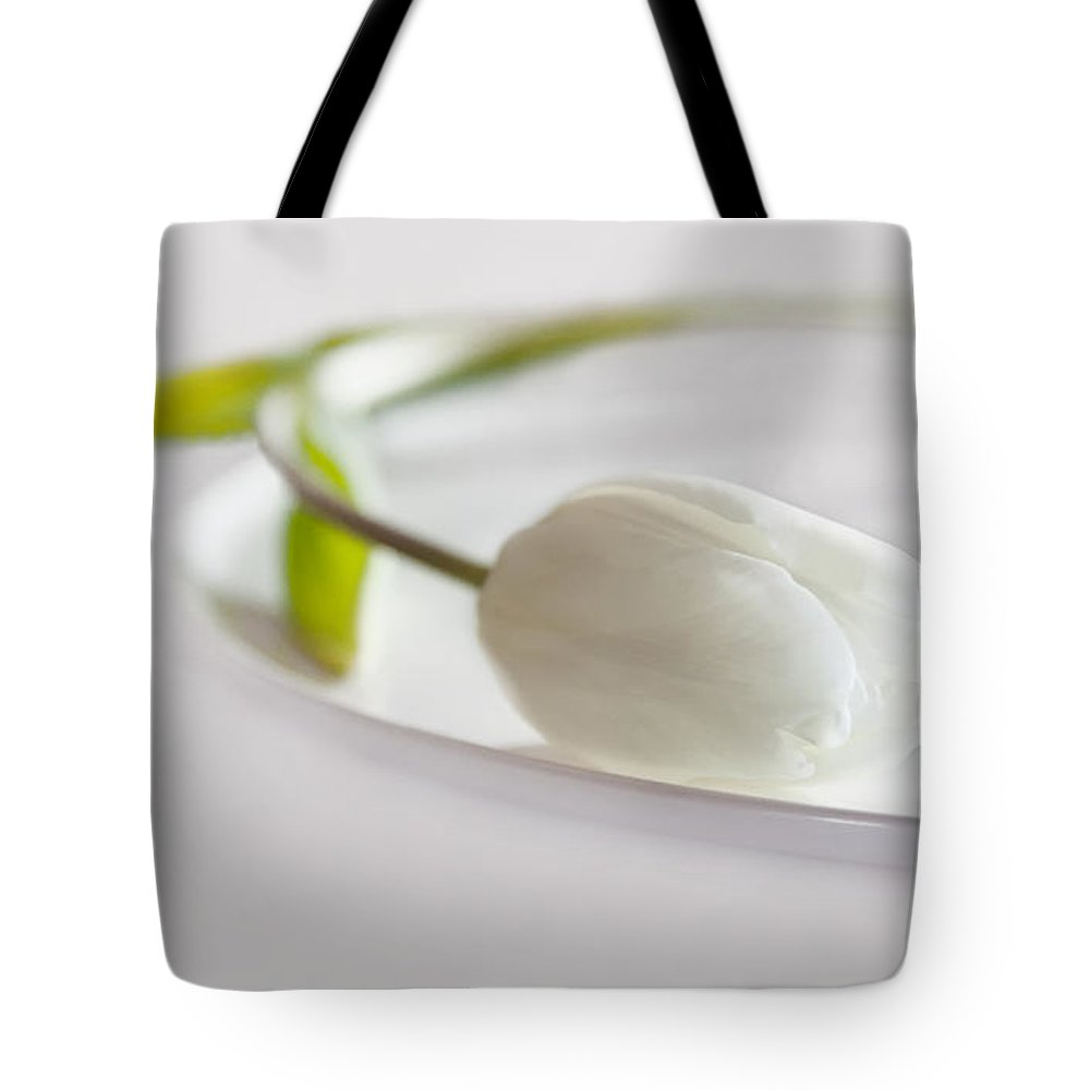 Tulip Tote Bag featuring the photograph White by Claudia Moeckel