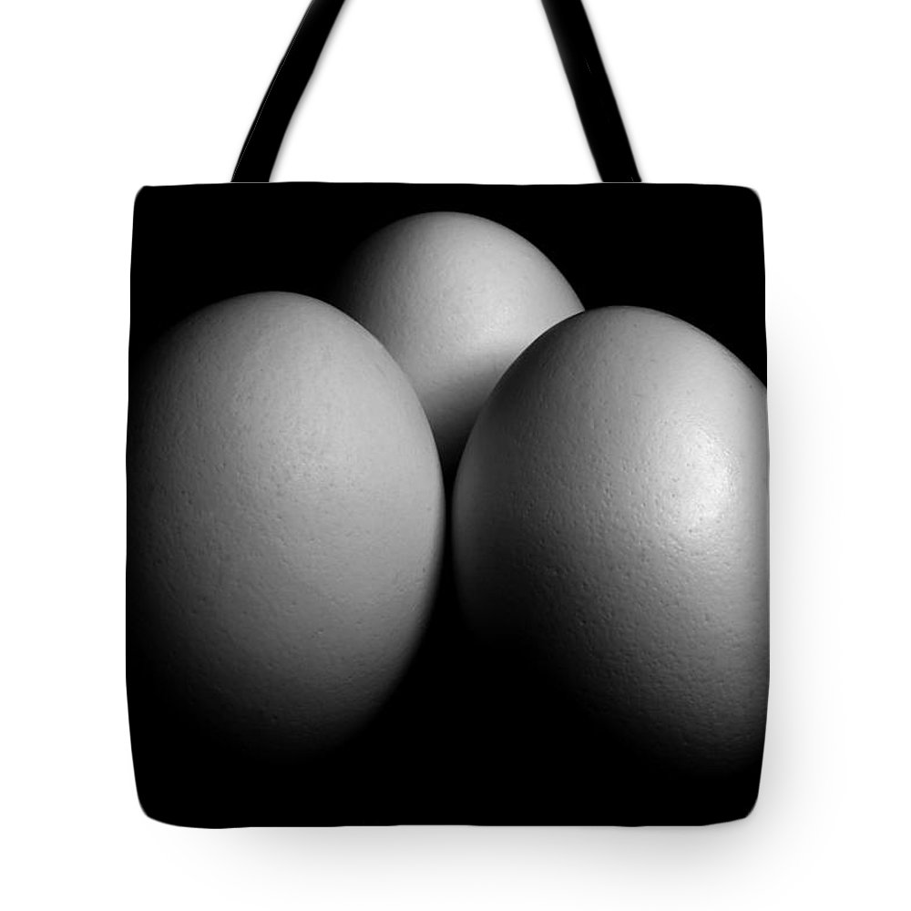 Eggs Tote Bag featuring the photograph White Eggs On Black by Donald Erickson