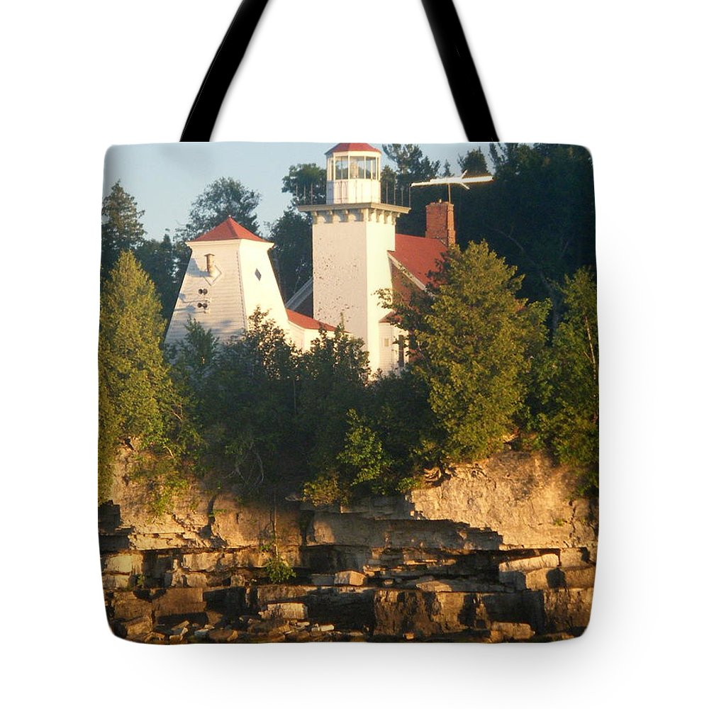 Lighthouse Tote Bag featuring the photograph White Lighthouse by April Patterson
