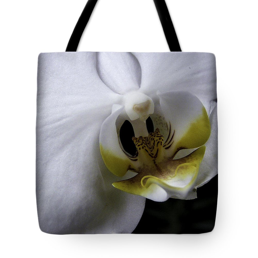 Flower Tote Bag featuring the photograph White Orchid by Lovejoy Creations
