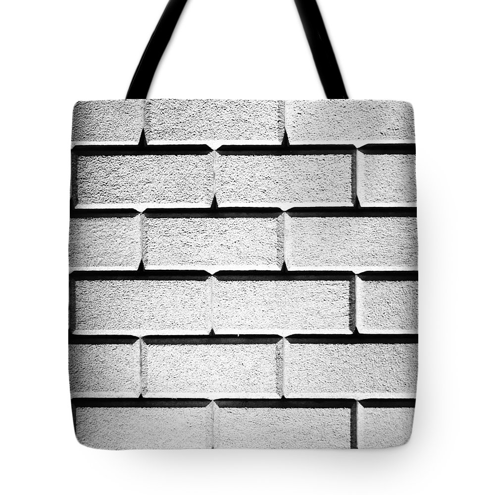 White Tote Bag featuring the photograph White Wall by Semmick Photo