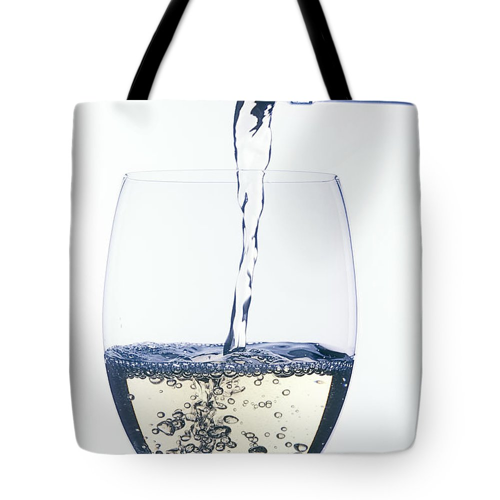 White Tote Bag featuring the photograph White Wine Pouring by Garry Gay