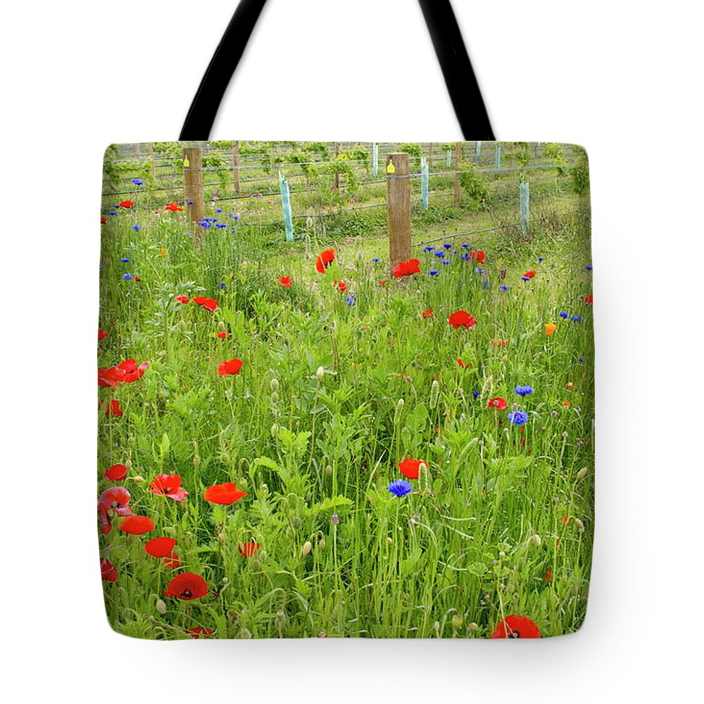 Scenics Tote Bag featuring the photograph Wild Flowers Along The Edge Of A by Lazingbee