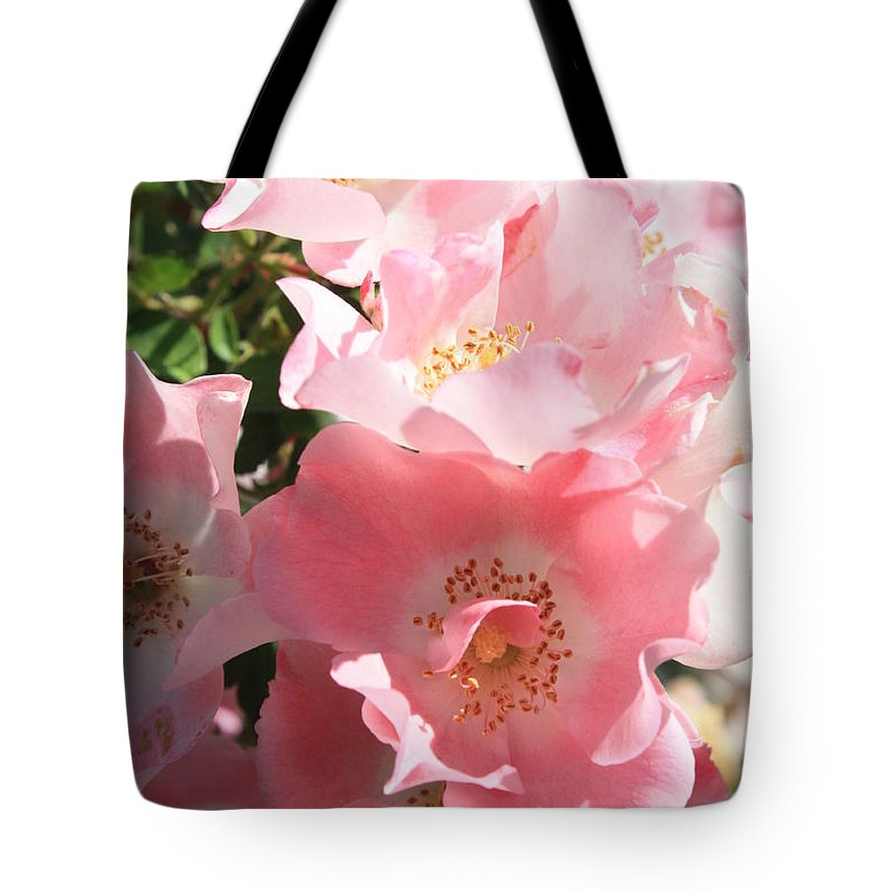 Wild Roses Tote Bag featuring the photograph Wild Roses by Carol Groenen