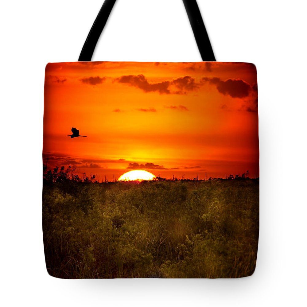 Sunset Tote Bag featuring the photograph Wild Sunset by Mark Andrew Thomas