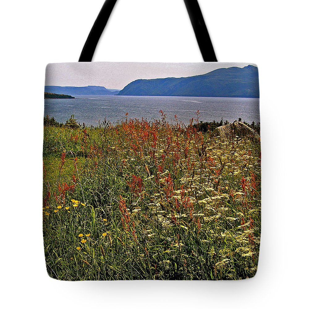 Wildflowers At Lobster Cove Head In Gros Morne Np Tote Bag featuring the photograph Wildflowers At Lobster Cove Head In Gros Morne Np-nl by Ruth Hager
