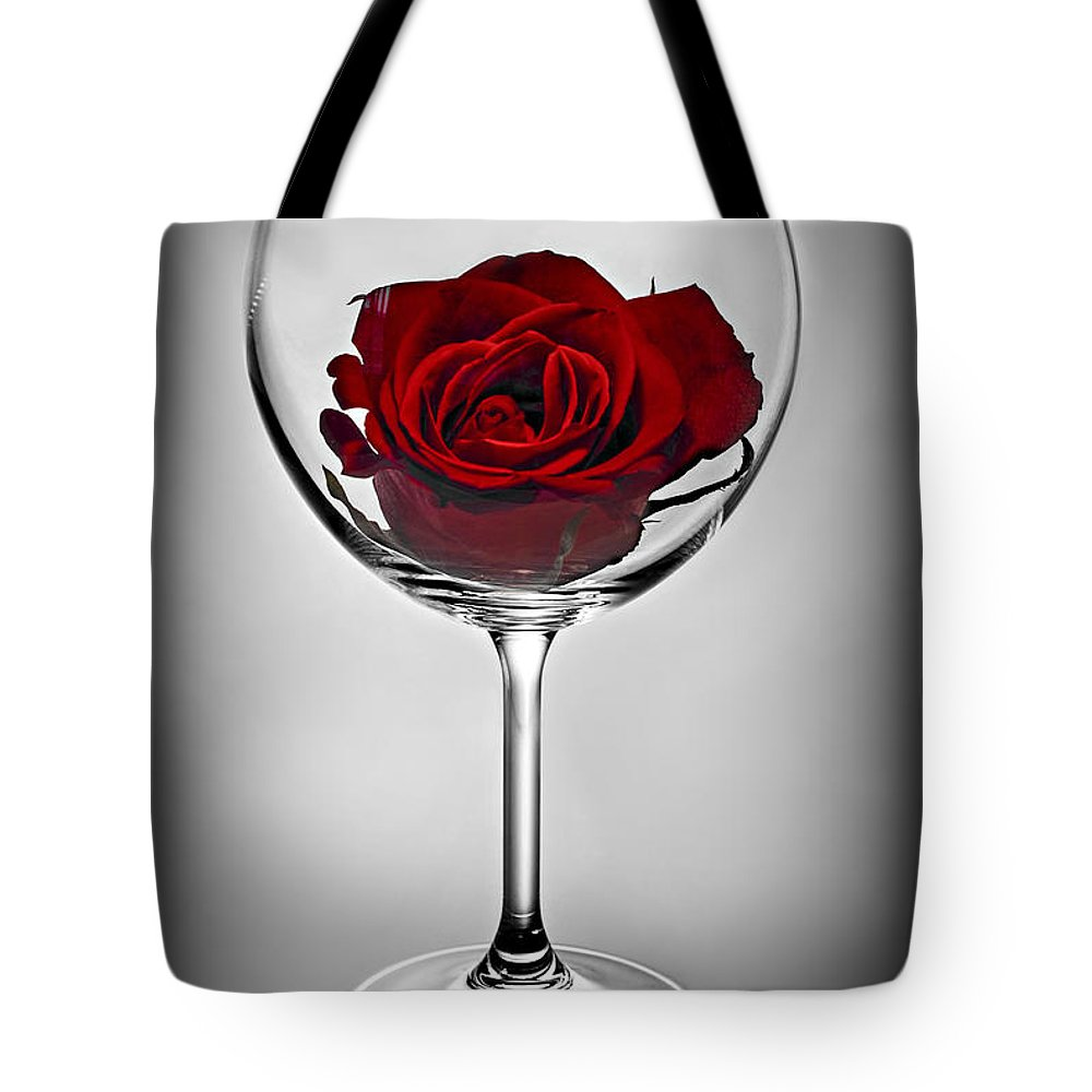 Glass Tote Bag featuring the photograph Wine Glass With Rose by Elena Elisseeva