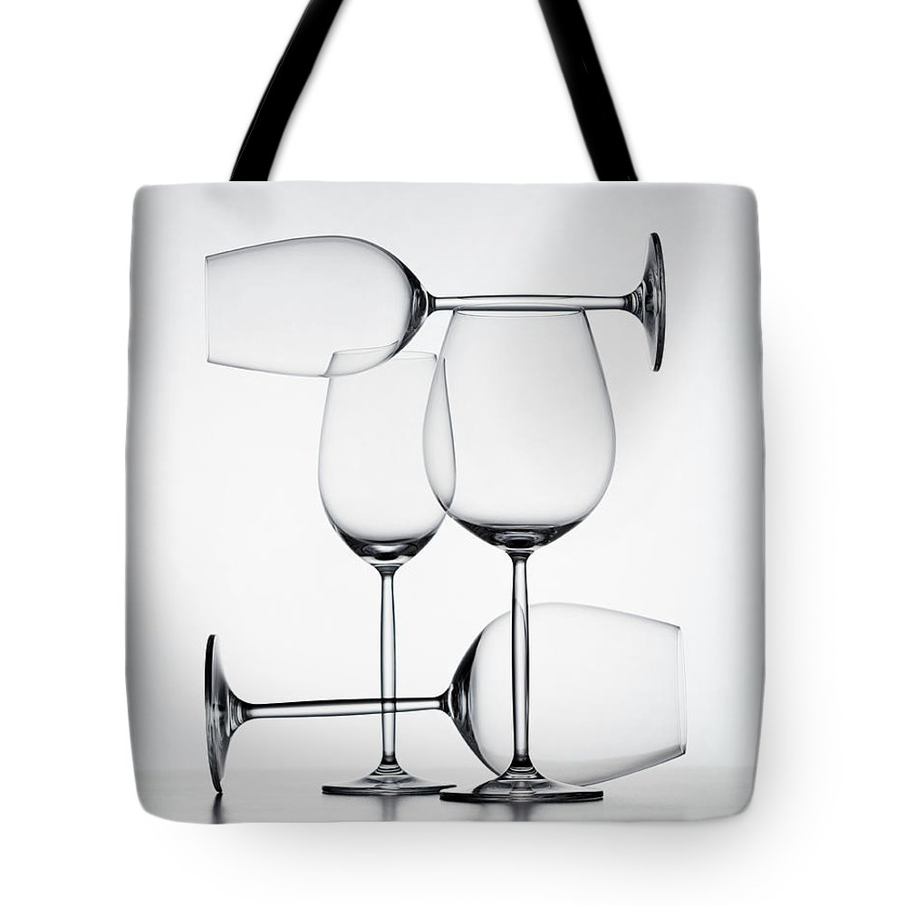 Empty Tote Bag featuring the photograph Wine Glasses by Jorg Greuel