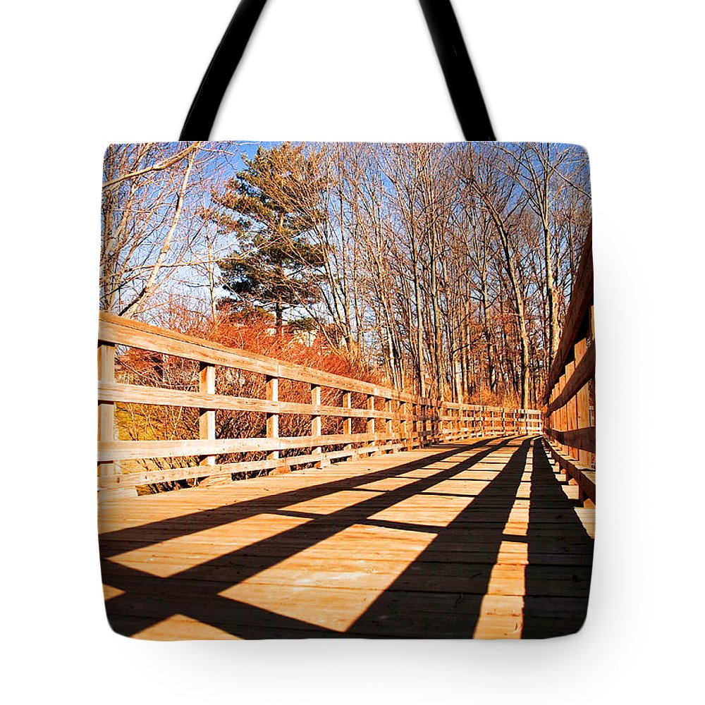 Bridge Tote Bag featuring the photograph Winter Spring Crossover by Frozen in Time Fine Art Photography
