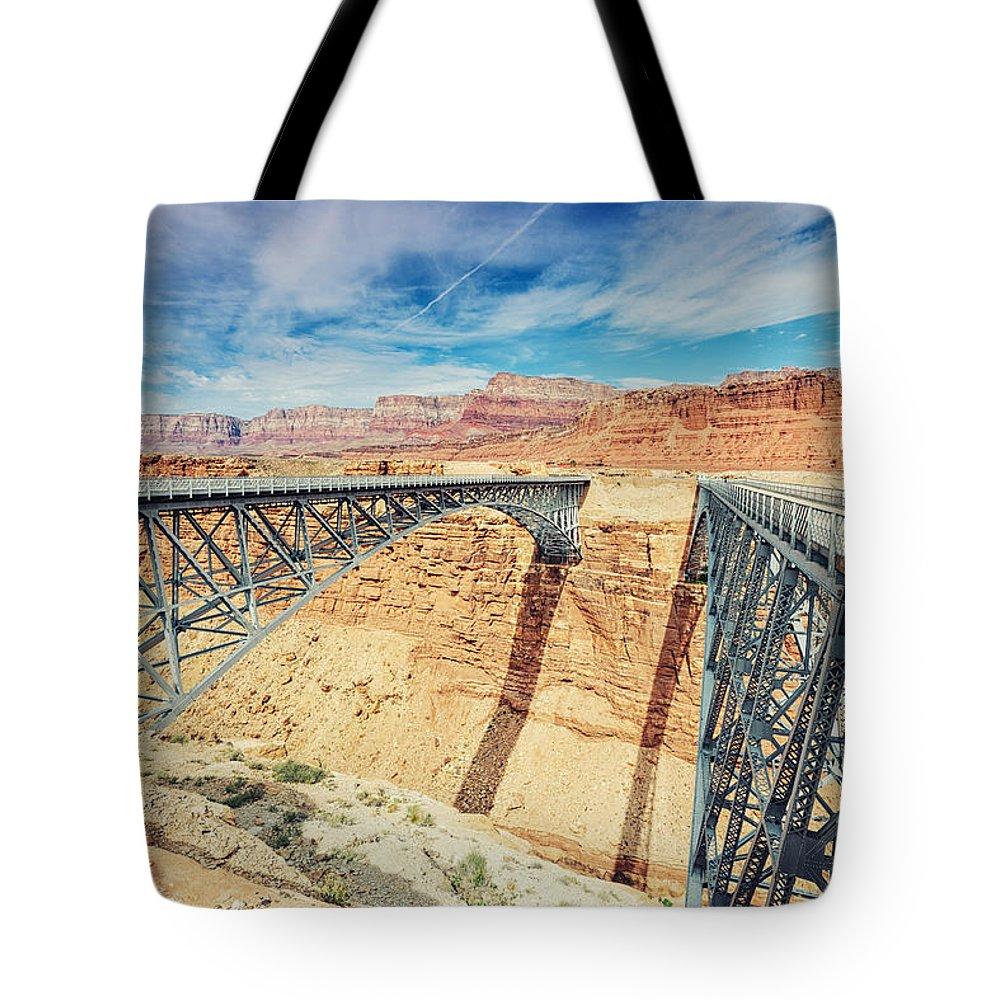 Grand Canyon Tote Bag featuring the photograph Wispy Clouds Over Navajo Bridge North Rim Grand Canyon Colorado River by Silvio Ligutti