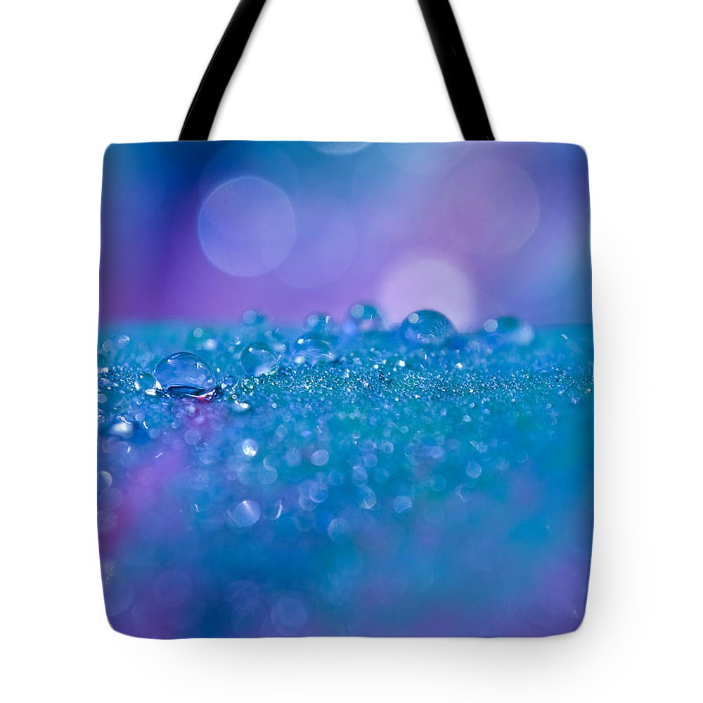 Water Droplets Tote Bag featuring the photograph With Grace And Ease... by Melanie Moraga
