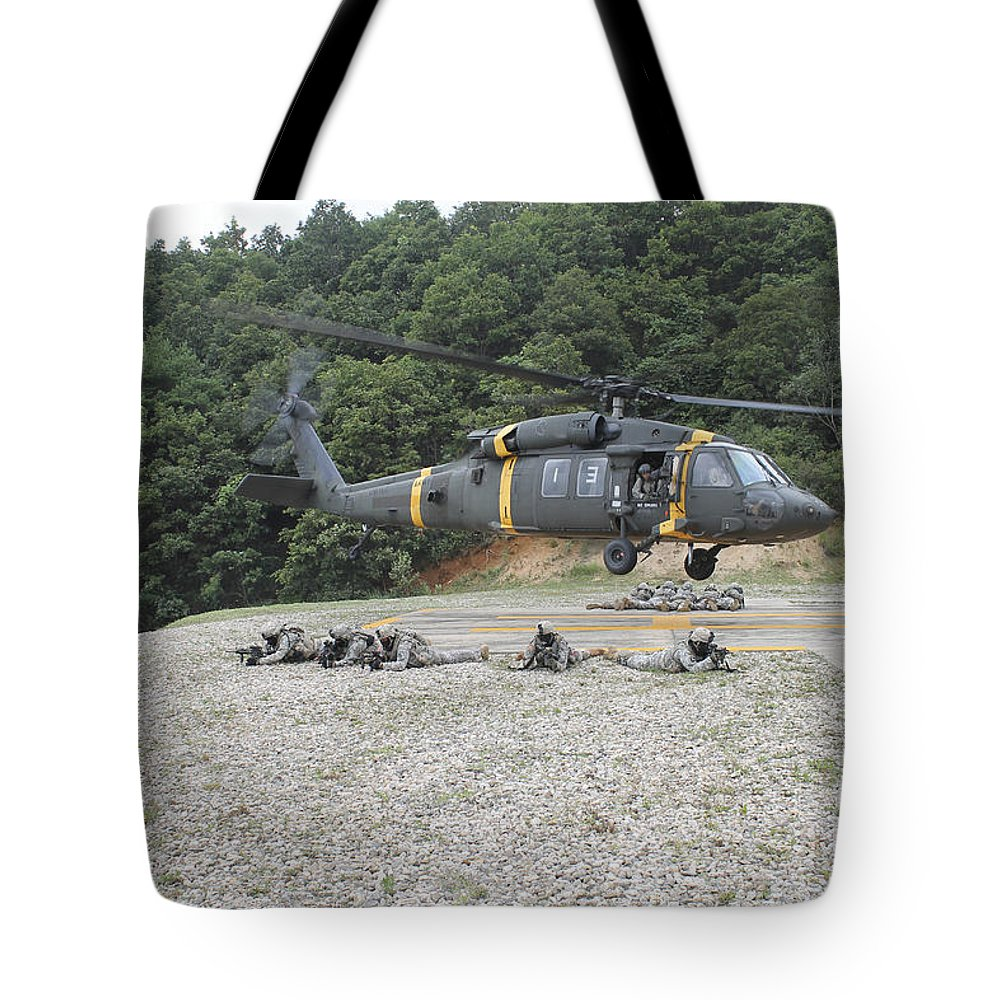 Military Tote Bag featuring the photograph Wolfhounds Air Assault From A Uh-60 by Stocktrek Images