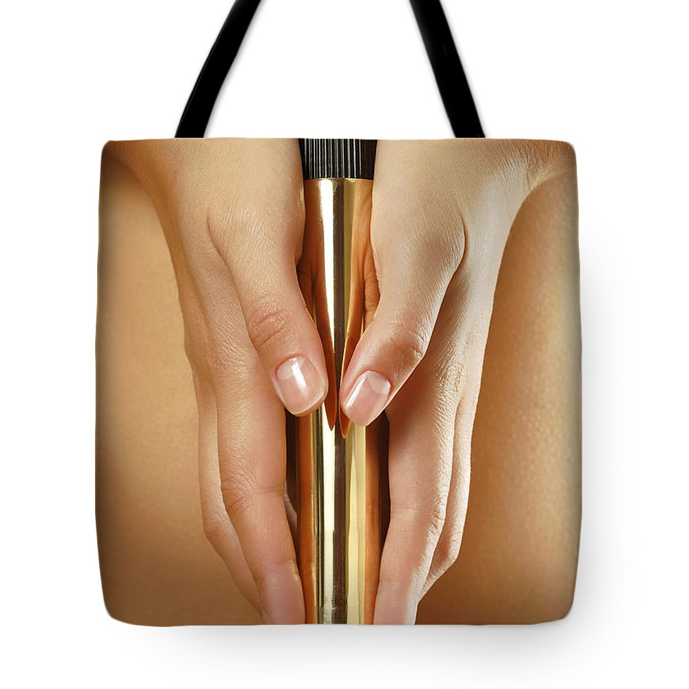 Vibrator Tote Bag featuring the photograph Woman Holding A Gold Vibrator by Oleksiy Maksymenko