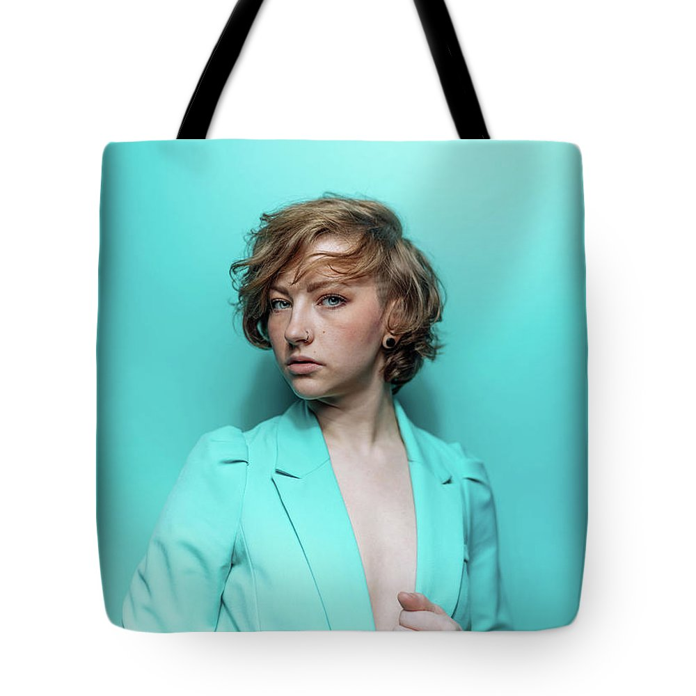 People Tote Bag featuring the photograph Woman In Blue Jacket On Blue Background by Ian Ross Pettigrew