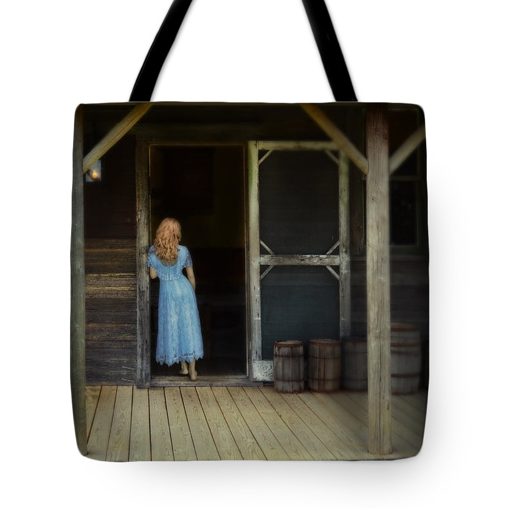 Woman Tote Bag featuring the photograph Woman In Cabin Doorway by Jill Battaglia