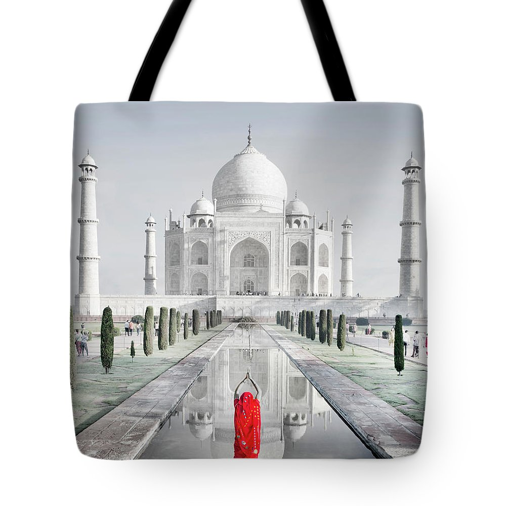 Tranquility Tote Bag featuring the photograph Woman In Red Sari Praying At Taj Mahal by Grant Faint