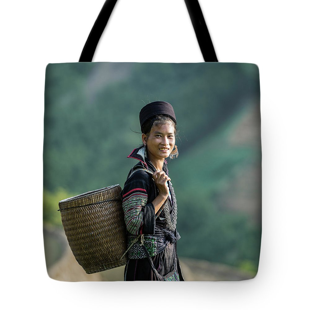 Farm Worker Tote Bag featuring the photograph Woman Of Black Hmong Hill Tribe Next To by Martin Puddy