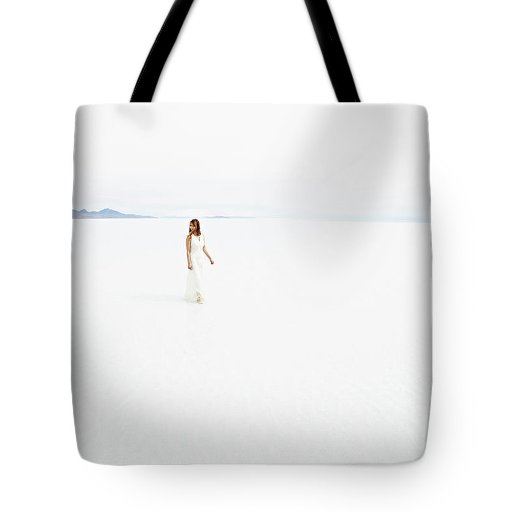 Scenics Tote Bag featuring the photograph Woman Wearing Dress Walking Through by Thomas Barwick