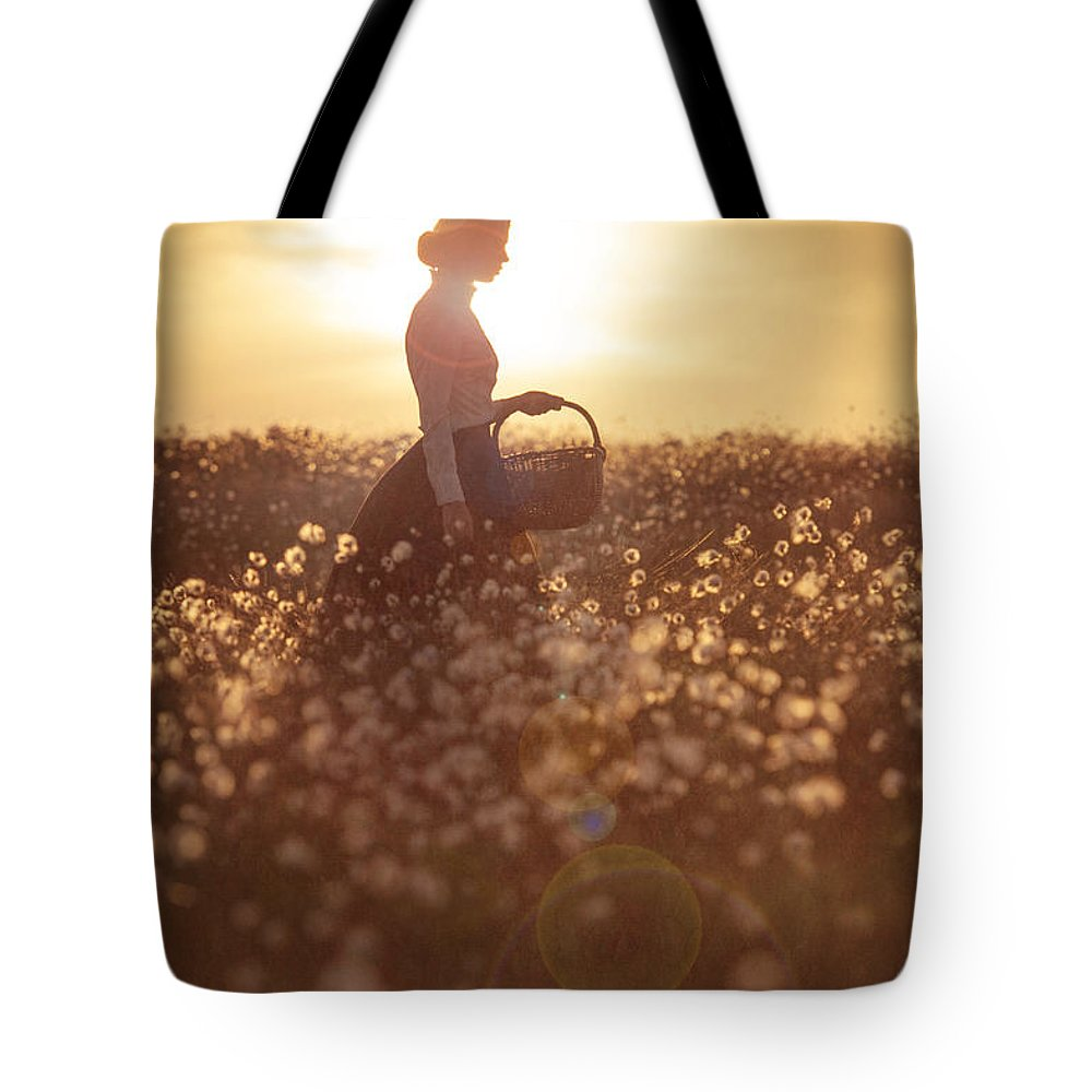 Edwardian Tote Bag featuring the photograph Woman With A Wicker Basket At Sunset by Lee Avison