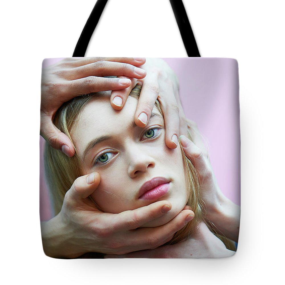 Young Men Tote Bag featuring the photograph Woman With Hands On Face by Tara Moore