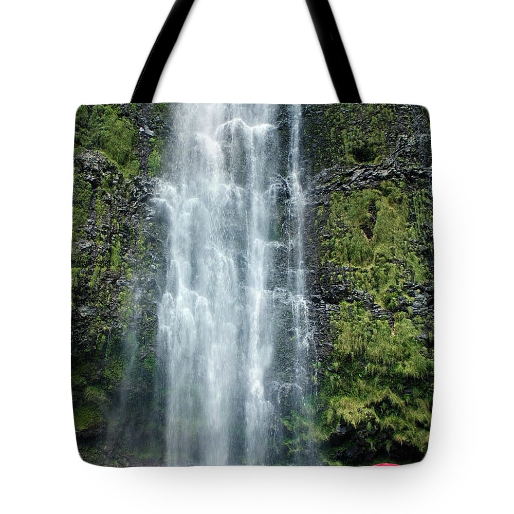 Beautiful Tote Bag featuring the photograph Woman With Umbrella At Wailua Falls by M Swiet Productions
