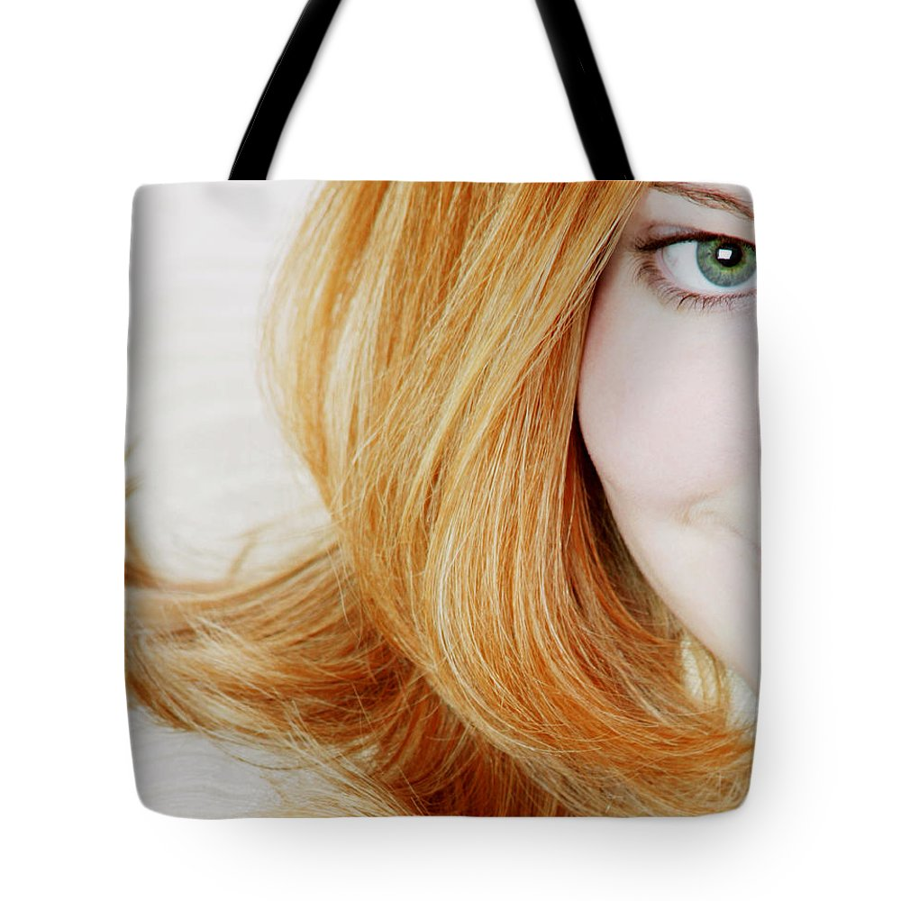 Female Tote Bag featuring the photograph Womans Face by Darren Greenwood