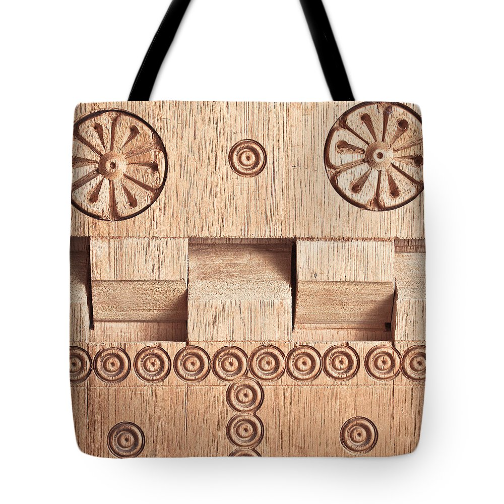Antique Tote Bag featuring the photograph Wood Carving by Tom Gowanlock