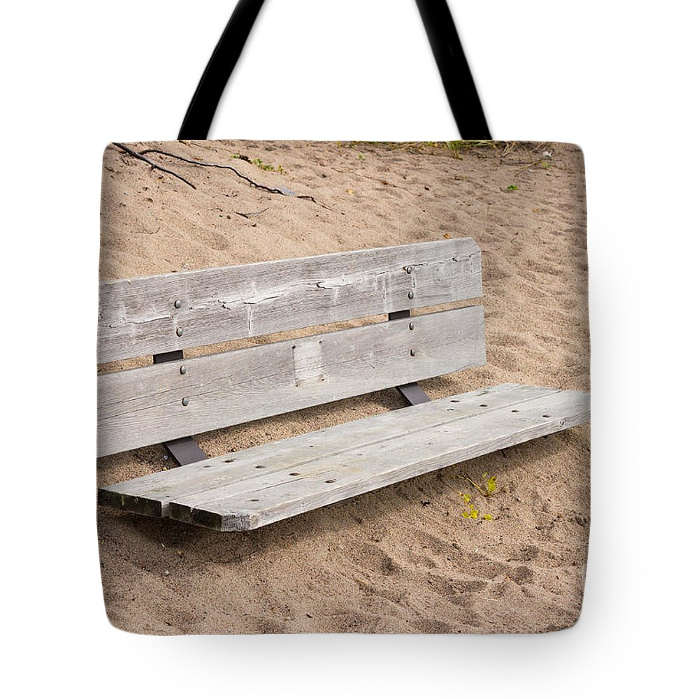 Wood Tote Bag featuring the photograph Wooden Bench Burried In The Sand by Les Palenik