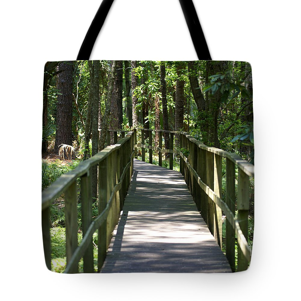 Board Tote Bag featuring the photograph Wooden Boardwalk Through The Forest by SAJE Photography