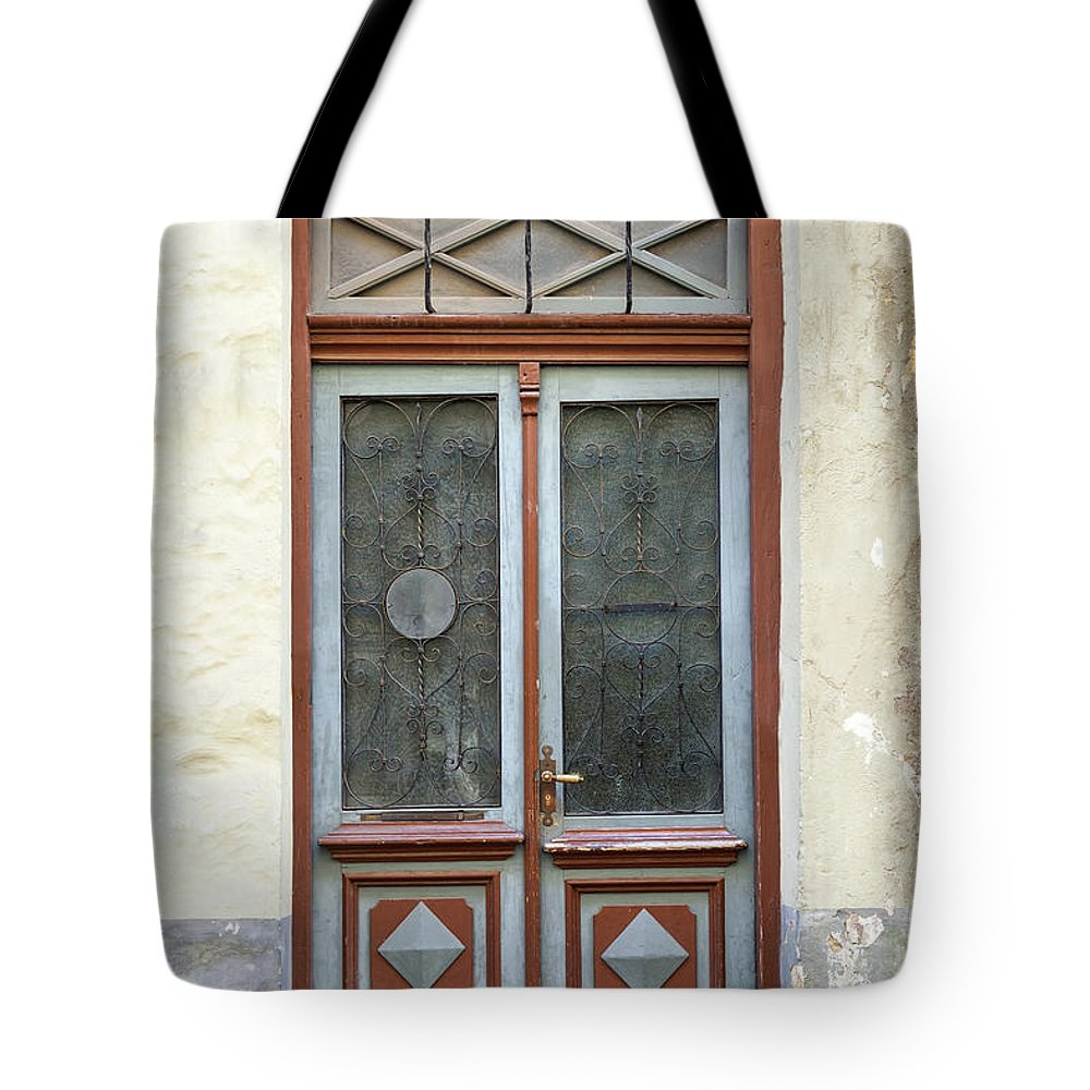 Rectangle Tote Bag featuring the photograph Wooden Door With Glass And Decoration by Eugenesergeev