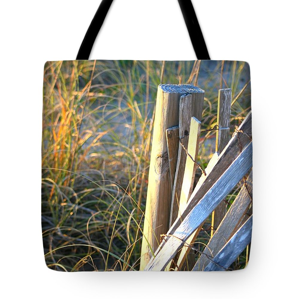 Post Tote Bag featuring the photograph Wooden Post And Fence At The Beach by Nadine Rippelmeyer
