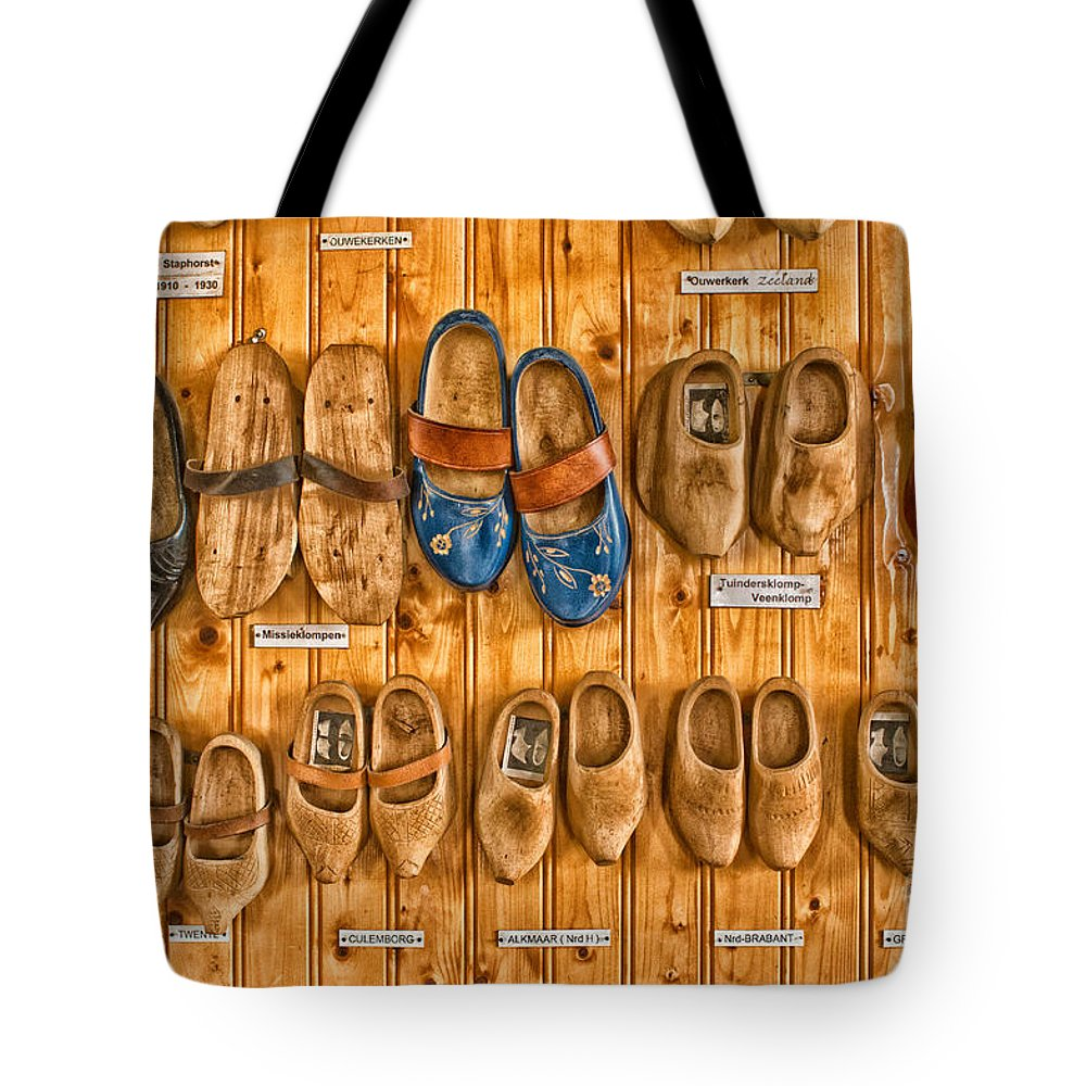 Wooden Shoes Tote Bag featuring the photograph Wooden Shoes by Brothers Beerens